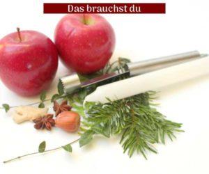 Material Äpfel, Konifere, Kerze, Nüsse und Apfelausstecher.