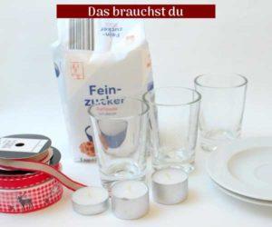 zucker, Wasser, Trinkgläser, Teelichte und Geschenkbänder